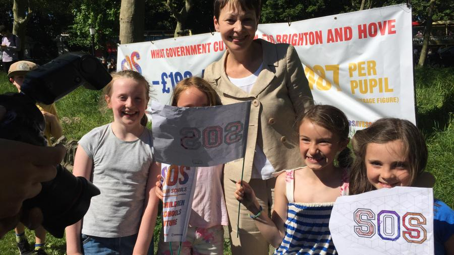 Caroline and children at the Save Our Schools rally